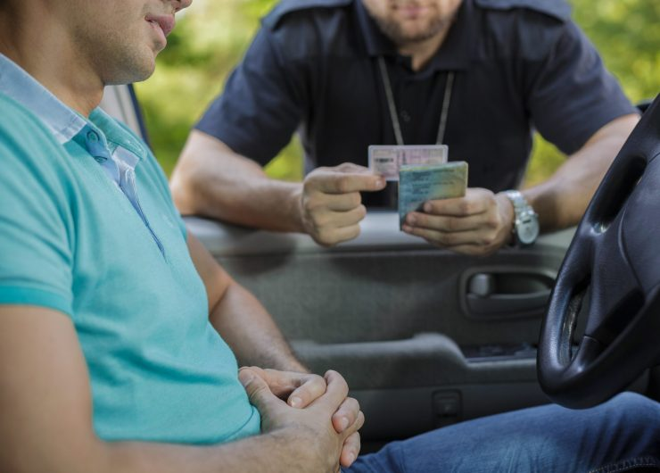 Young male driver stopped for policeman's control
